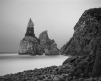 Moonlit Ursa beach. Ursa rock before loosing his head, Ursa beach, Portugal. Moonlit seascape. Long exposure. Analog: 120 film stock photo