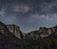 Moonlit Valley of Yosemite - California. The Yosemite Valley, as seen from Tunnel View, is softly illuminated by the setting moon with the Milky Way above. El royalty free stock photography