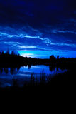 Moonrise. Over a beaver pond, Elk Island National Park Alberta Canada royalty free stock photo