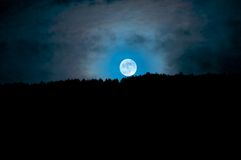 Moonrise above the trees, Camarda, Abruzzo, Italy Stock Photos