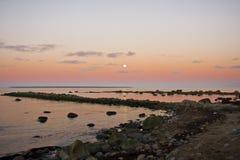 Moonrise And Cobble Moles Stock Photo