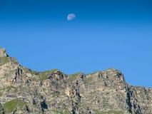 Moonrise in daylight Royalty Free Stock Photo