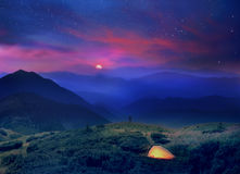 Moonrise in the foothills of the Alps. A beautiful moonrise in the foothills of the Alps affect the viewer's imagination, dense virgin forests on the slopes stock photo