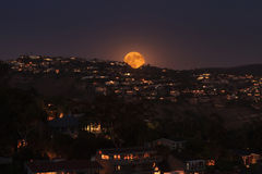 Moonrise of a full moon over the coastline of Laguna Beach Stock Photography