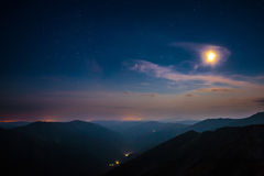 Moonrise in the mountains Royalty Free Stock Photos