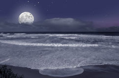 Moonrise on the ocean Stock Photography