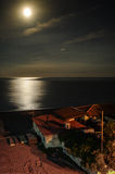 Moonrise. At the one of the beaches of southern Sicily Stock Photography