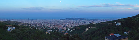 Moonrise over Barcelona city Royalty Free Stock Photo