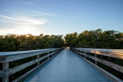 Moonrise over the Boardwalk leading to Pass. At sunset in Naples, Florida stock image