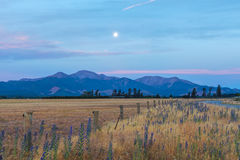 Moonrise over Canterbury Hills and farmland, New Zealand Stock Images