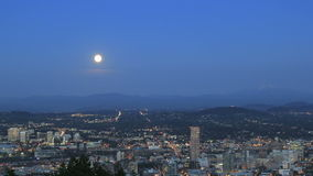 Moonrise Over Cityscape and Mountain Range at Blue Hour Royalty Free Stock Photography