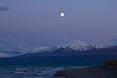Moonrise over Kluane Lake near Kluane National Park Stock Image