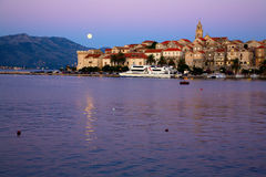 Moonrise over Korcula. Scenic view of city of Korcula in Croatia with rising full moon Royalty Free Stock Photography