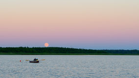 Moonrise over the lake Royalty Free Stock Images
