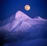 Moonrise over Montenegro. Moonrise among alpine peaks, unforgettable beauty of the spectacle, worth dangerous night-climbing in winter. Goverla-highest point of stock images