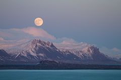 Moonrise over mountains royalty free stock photos