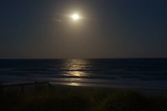 Moonrise over the Ocean. A full moon rises over the ocean off the coast on Emerald Isle, North Carolina Stock Images
