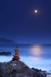 Moonrise over the ocean Stock Photo