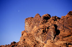 Moonrise over red rocks Royalty Free Stock Photo