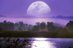 Moonrise Over The River Stock Photos