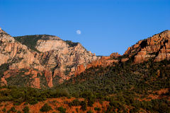 Moonrise over the rocks surrounding Sedona, Arizona Stock Image