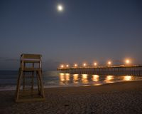 Moonrise over Strand Stock Foto's