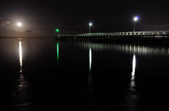 Moonrise over Wellington Point. Full moon rising over Wellington Point pier, Redlandshire on Brisbane's Bayside Stock Image