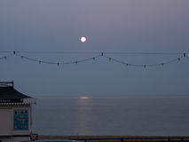 Moonrise at the seaside. View of the seacoast with rising moon in the evening stock photo