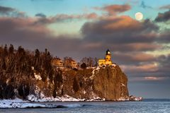 Split Rock Lighthouse in winter. Moonrise and sunset at Split Rock Lighthouse, North Shore of Lake Superior, Minnesota Stock Photos