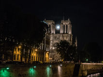 Moonrise between the towers of Notre Dame, Paris Stock Images