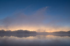 Moonrise Whitford Lake. In fog, Fort Custer State Park, Michigan, USA stock image