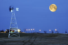 Moonrise and Windmill Stock Photo