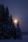 Moonrise at winter evening countryside Stock Photo