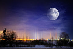 Moons in winter landscape Stock Image