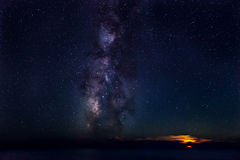 Moonset & Milky Way. The Milky Way, rising out of the Mediterranean Sea, next to a setting Moon stock photo