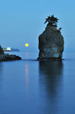 Moonset in the morning at siwash rock Royalty Free Stock Images
