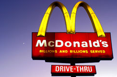 Moonset Over Golden Arches Stock Photography