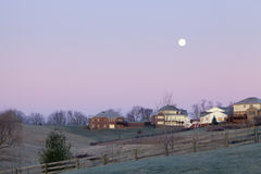 Moonset over a neighborhood Stock Photo