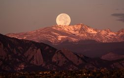 Moonset over the rocky mountains, behind Boulder Colorado. Moonset behind Boulder Colorado and the rocky mountains, taken on a clear October morning royalty free stock image