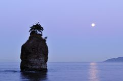 Moonset at siwash rock, stanley park Royalty Free Stock Photo