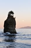 Moonset at siwash rock, stanley park Royalty Free Stock Image