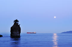 Moonset at siwash rock, stanley park Stock Photo