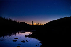 Moonset with Venus. Moonset in the Sierra Nevada's California Alps. Venus visible nearby royalty free stock photo