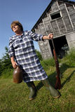 Moonshine Mary. Stands proud protecting her moonshine with a rather large shotgun stock image
