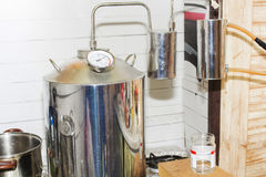 Moonshine still in action, at home. Alcohol mashine royalty free stock photography
