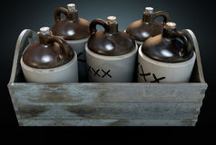 Moonshine In Wooden Crate. A 3D render of a collection of five vintage moonshine jugs in a wooden carry crate on an isolated dark studio background royalty free stock image