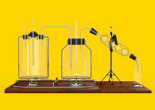 Moonshine on yellow background. Moonshine alcohol maсhine for production of vodka, brew and hooch. manufacture of hootch. System glass flasks, retort and a royalty free stock images