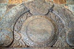 Moonstone or Sandakada pahana. Sandakada pahana also known as a moonstone is a feature of Sinhalese architecture in ancient Sri Lanka. Buddha`s Tooth Relic Royalty Free Stock Photography