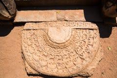 Moonstone or Sandakada pahana. Sandakada pahana also known as a moonstone is a feature of Sinhalese architecture in ancient Sri Lanka Stock Photos