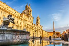 The Moor Fountain and the Fountain of Neptune and the basilica in Piazza Navona royalty free stock images